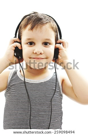 The young boy is smiling and listening to music. Isolated on white background - stock photo