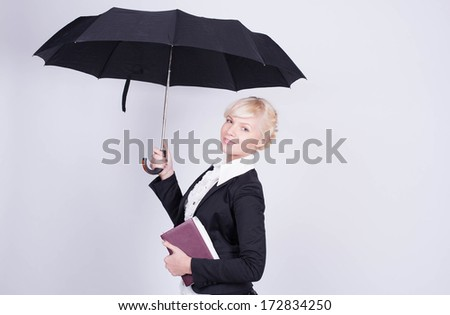 the young business woman with an umbrella and a notebook - stock photo