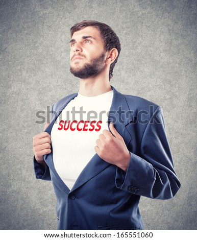 The young businessman in movement to the success - stock photo