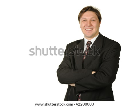 The young businessman isolated on a white background. A portrait of the man.