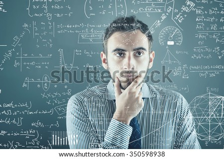 The young businessman tries to solve problems - stock photo