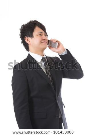 The young businessman who talks on the telephone