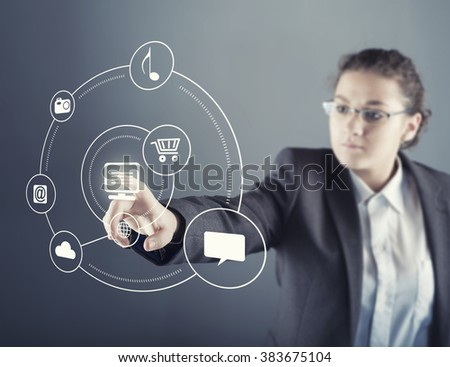 The young  businesswoman touching virtual screen; computer possibilities and connections - stock photo
