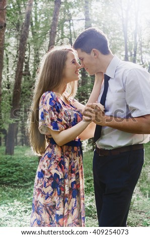 the young couple of lovers walks in park