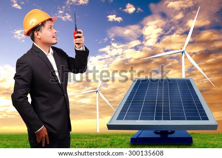 The young engineer , wind turbines and solar cells.