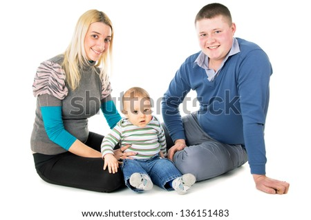 The young family was sitting on the floor with child isolated on white background