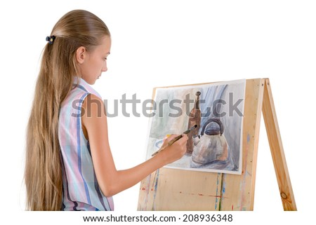 The young girl draws on an easel - stock photo