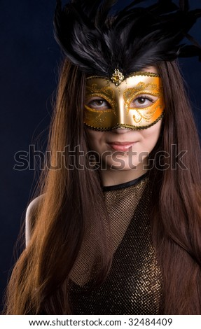 The young girl in a mask, is photographed on a dark blue background