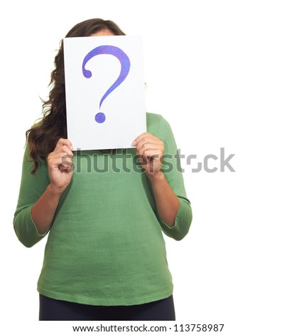 The young girl in green shirt holding a sheet of paper with a big question mark, covering her face. Isolated on white background