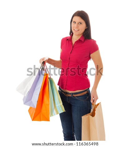 The young girl is carrying a lot of shopping bags
