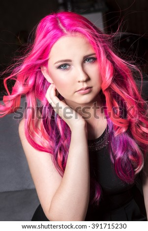 The young girl with pink hair and makeup