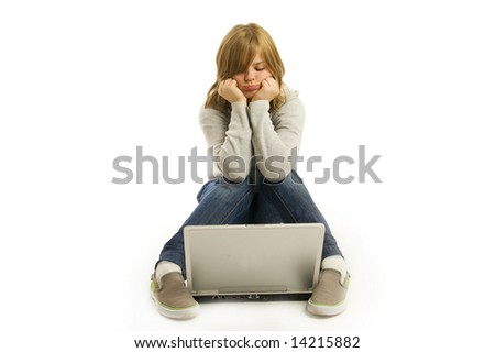 The young girl with the laptop isolated on a white background - stock photo