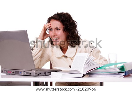 the young girl works behind a computer at office - stock photo