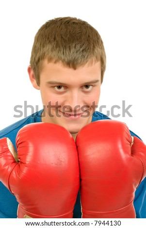 The young guy - boxer in red boxing gloves