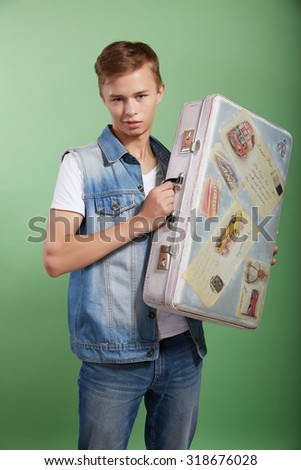 the young guy with a vintage suitcase