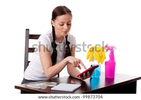 The young housewife plans the family budget on a white background.