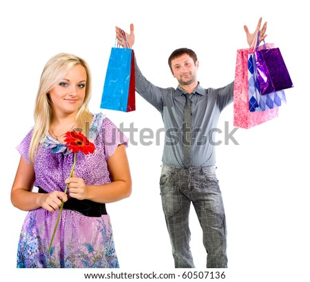 The young man and the woman with purchases