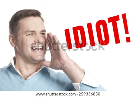 The young man announces declares: idiot! - stock photo