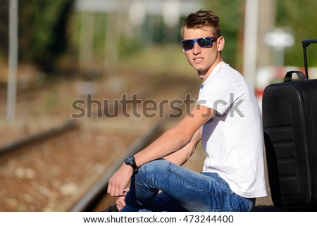 The young man at the railway station.