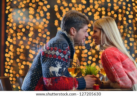 The young man gives a wedding ring   gift to  girl in restaurant - stock photo