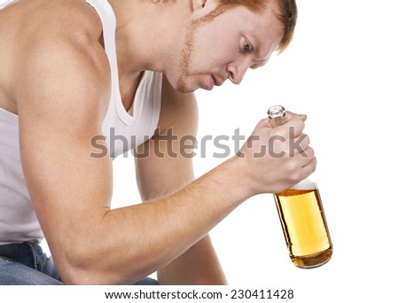 The young man has awful problems with alcohol. Depression and alcoholism one of the most widespread illnesses of XXI centuries. Beer alcoholism - stock photo