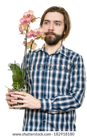 the young man, holds an orchid flower in hand - stock photo