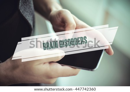 The young man holds the hand Brain Disorders by smartphone - stock photo