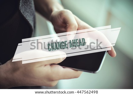 The young man holds the hand Change Ahead by smartphone - stock photo