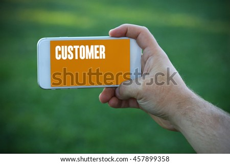 The young man holds the hand Customer by smartphone - stock photo