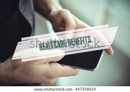 The young man holds the hand Health Care Benefits  by smartphone - stock photo