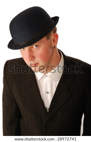 The young man in a suit and a soft felt hat.