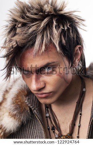 The young man in image of a wolf - stock photo