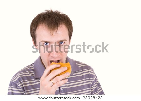 The young man is appetizing eats a hamburger.