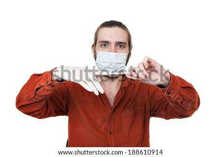 the young man removing a medical rubber glove - stock photo