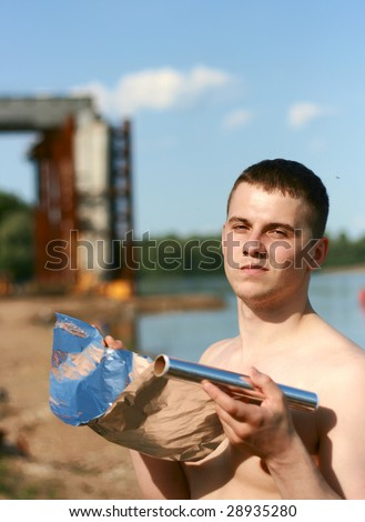The young man sunbathes on the sun - stock photo