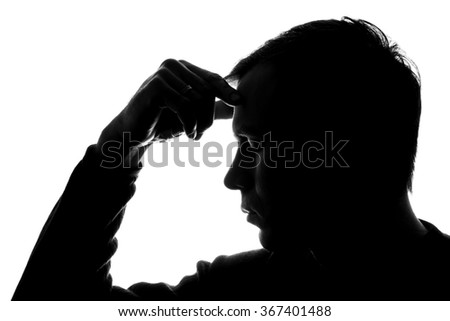 The young man thought his head propped on his hand - silhouette