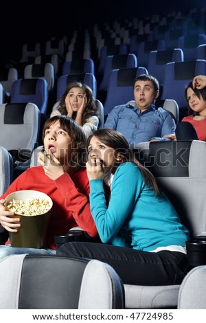 The young men frightened of viewing of cinema - stock photo