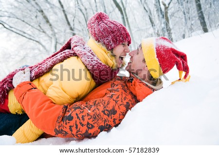 The young pair kisses in the winter Valentine's day