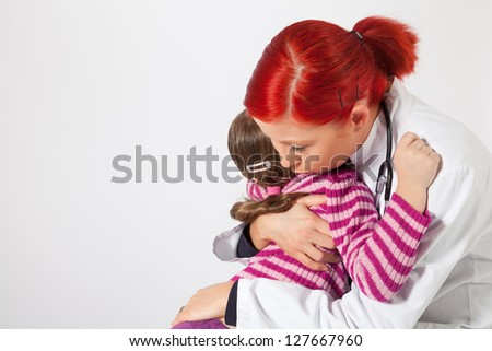 The young pediatrician comforted a little girl