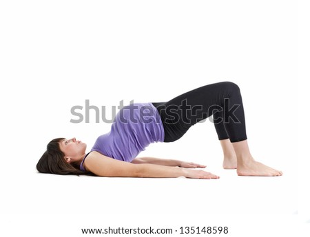 the young pregnant woman is engaged in fitness - stock photo