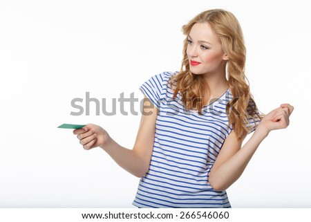 The young smiling woman giving you the card of the blank credit on a white background - stock photo