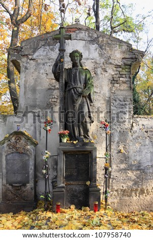 The young stone Girl on an old Prague Cemetery, Czech Republic - stock photo