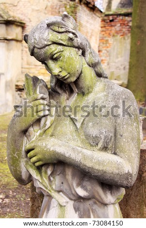 The young stone Woman from the old Prague Cemetery - stock photo