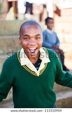 The young teenager is screaming from excitement and happiness. - stock photo