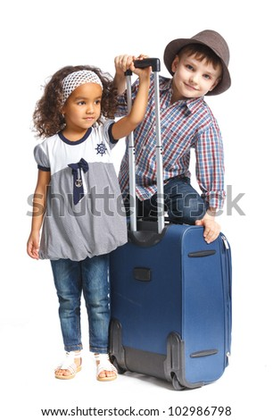 The young traveler brother and sister with a suitcase. Isolated over white background - stock photo