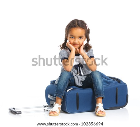 The young traveler mulatto girl with a suitcase. Isolated over white background - stock photo