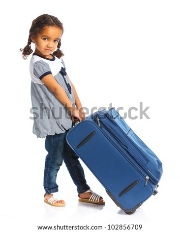 The young traveler mulatto girl with a suitcase. Isolated over white background