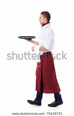 The young waiter with a tray on a white background - stock photo