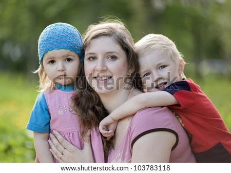 The young woman and two children - stock photo