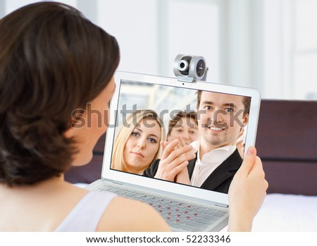 the young woman chatting via the webcam - stock photo
